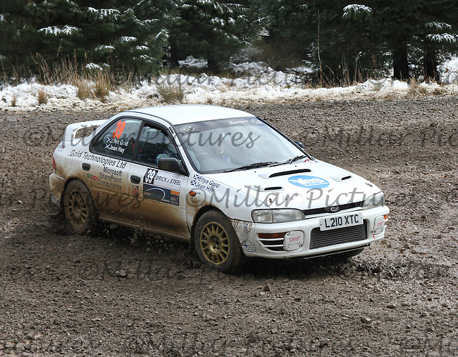 Ellya Gold - Jean Hay in a Subaru Impreza at Junction 6 on Special Stage 1 Riccarton on the Brick & Steel Border Counties Rally 2014, Round 2 of the RAC MSA Scottish Rally Championship sponsored by ARR Craib Transport Limited and other championships  and organised by Whickham & District and Hawick & Border Car Clubs and based in Jedburgh and held in Kielder Forest on 22.3.14.