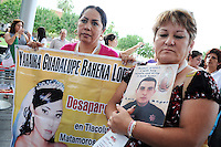 "Phoenix, Arizona - Margarita Lopez Perez (left) and Araceli Magdalena Rodriguez (right) hold photographs of their missing children. The women are members of the ""Caravan for Peace with Justice and Dignity"" who participated in a rally and vigil at the Civic Space Park in Downtown Phoenix. Both women joined the caravan in hopes to find their children and to create awareness about the violence in Mexico. Margarita's daughter, Yahaira Guadalupe Bahena Lopez, was carrying a banner with her daughter's wedding photo. Yahaira is the wife of a federal police officer. She was abducted by gunmen from her home in the State of Oaxaca, Mexico. Margarita's own search led her to learn that her daughter had been killed and decapitated. Araceli Magdalena Rodriguez, the woman on the right, was holding a photograph of her son Luis Angel Leon Rodriguez, a federal police officer who went missing in November 2009. According to Araceli, authorities informed her that members of drug cartel and executed his son. None of the two mothers have confirmed their children's deaths nor recovered their bodies. The ""Caravan for Peace with Justice and Dignity"" stopped in Phoenix on Wednesday, August 15, 2012 as it travels across the United States as a way to create awareness in the United States about the failed drug war in Mexico that has left more than 70,000 dead. The caravan is led by Mexican poet, essayist, novelist, and journalist Javier Sicilia, whose son Juan Francisco Sicilia Ortega son was brutally murdered along with six other students in Morelos, Mexico by members of a drug cartel on March 28, 2011. In response, Sicilia created the Movement for Peace with Justice and Dignity --popularly known as ¡Ya Estamos Hasta la Madre! or We Have Had It!-- calling for an end the drug cartels bloodshed. Photo by Eduardo Barraza © 2012"