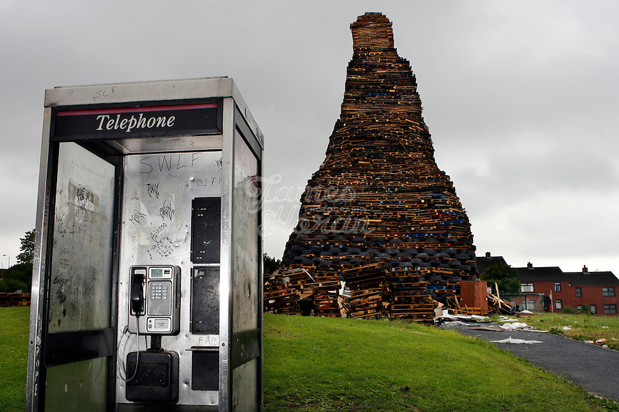 The 30 meter tower of pallets and old tires that will become a giant bonfire to burn the Irish flag on the Loyalist estate of New Mossley, Belfast Northern Ireland.The bonfires which are seen by the Protestant community as a celebration of loyalist culture in the province are lit on the eve of 12 July, which is the anniversary of the Battle of the Boyne at which the Protestant King William of Orange defeated the Catholic King James in 1690. The festival causes outrage in the nearby republician and Catholic areas of the city.