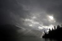 Sunlight streams through a break in the storm clouds on Baker Lake near Concrete, Wash., Fri., Sept., 28, 2007.