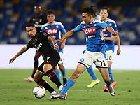 12th July 2020; Stadio San Paolo, Naples, Campania, Italy; Serie A Football, Napoli versus AC Milan; Hirving Lozano of Napoli challenges Ismael Bennacer of AC Milan