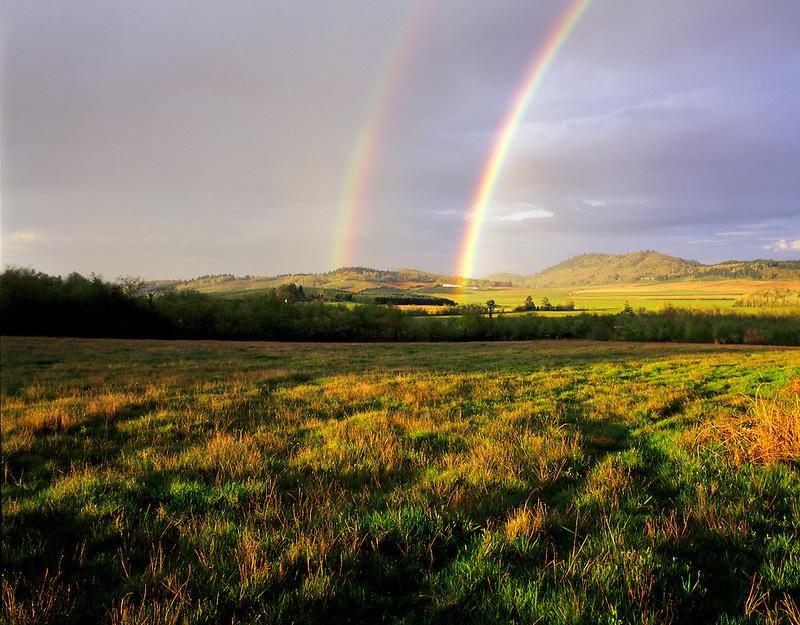 Rainbow and pastureland. Near Alpine, Oregon.