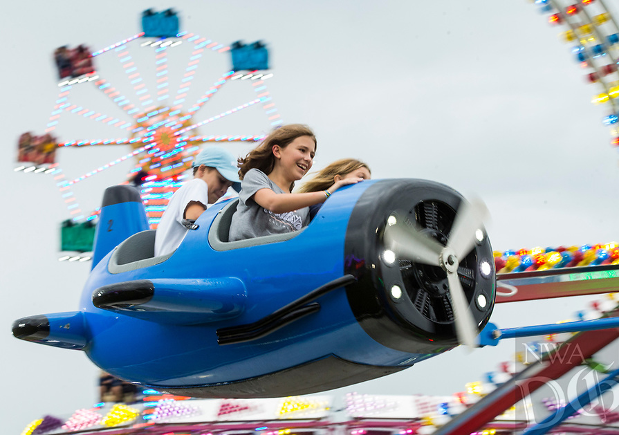 NWA Democrat-Gazette/BEN GOFF @NWABENGOFF<br /> Guests take a spin on a ride Thursday, Aug. 8, 2019, during the Benton County Fair in Bentonville.