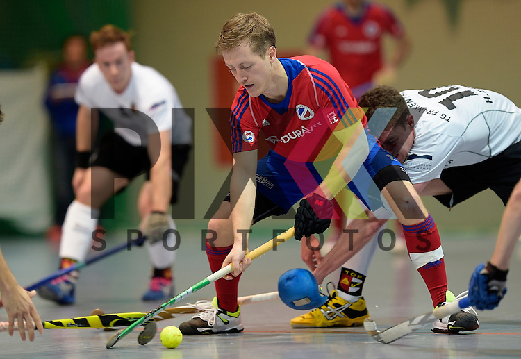 GER - Mannheim, Germany, November 28: During the 1. Bundesliga Sued Herren indoor hockey match between Mannheimer HC (red) and TG Frankenthal (white) on November 28, 2015 at Irma-Roechling-Halle in Mannheim, Germany. Final score 7-7 (HT 3-3).  Hans-Christian Damm #10 of TG Frankenthal, Jan Philipp Fischer #2 of Mannheimer HC<br /> <br /> Foto &copy; PIX-Sportfotos *** Foto ist honorarpflichtig! *** Auf Anfrage in hoeherer Qualitaet/Aufloesung. Belegexemplar erbeten. Veroeffentlichung ausschliesslich fuer journalistisch-publizistische Zwecke. For editorial use only.