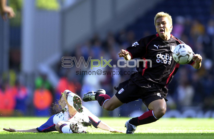 Pix: Matthew Lewis/SWpix.com. Soccer. FA Barclaycard Premiership. Blackburn Rovers v Fulham. 28/09/03...COPYRIGHT PICTURE>>SIMON WILKINSON>>0870 092 0092>>..Fulhams Junichi Inamoto is tackled by Blackburns Barry Ferguson.