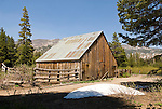 Wooden hay barn and horse corral at the cow camp in Tryon Meadow in the  high Sierra Nevada of California.