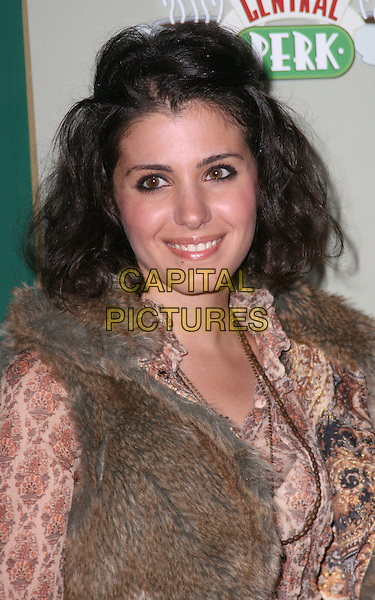 KATIE MELUA .Attending the Central Perk Launch Party, Carnaby Street, London, England, UK,.September 23rd 2009..portrait headshot fur gilet print top cream red patterned paisley .CAP/JIL.©Jill Mayhew/Capital Pictures