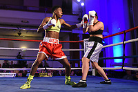 Cherrelle Brown (red shorts) defeats Monika Antonik during a Boxing Show at the Camden Centre on 10th March 2018