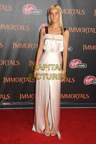 "Isabel Lucas.""Immortals"" World Premiere held at Nokia Theatre LA Live, Los Angeles, California, USA..November 7th, 2011.full length dress slit split pink white silk satin straps maroon braid plait hair.CAP/ADM/BP.©Byron Purvis/AdMedia/Capital Pictures."