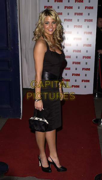GEMMA ATKINSON.The FHM 100 Sexiest Women In The World Party 2006 at Madame Tussauds, London, UK. .May 3rd, 2006.Ref: CAN.full length black dress purse.www.capitalpictures.com.sales@capitalpictures.com.©Capital Pictures