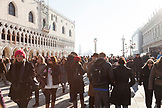 ITALY, Venice.  A view of a crowded St. Mark's Square with the Doge's Palace on the left and the Columns of the Lion and San Teodoro on the right. The island of San Giorgio Maggiore and Giudecca can be seen in the distance.
