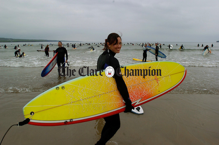Susan Lambert of Ennis heads out to take part  in the Lahinch Surfschool Crew's Surfing World Record Festival at Lahinch beach. Photograph by John Kelly.