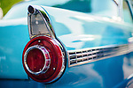 Red tail light on blue classic car