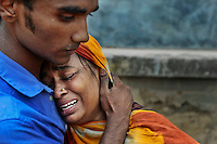 Relatives mourn a victim at the site where an eight-story building housing several garment factories collapsed in Savar, near Dhaka, Bangladesh, Wednesday, April 24, 2013.