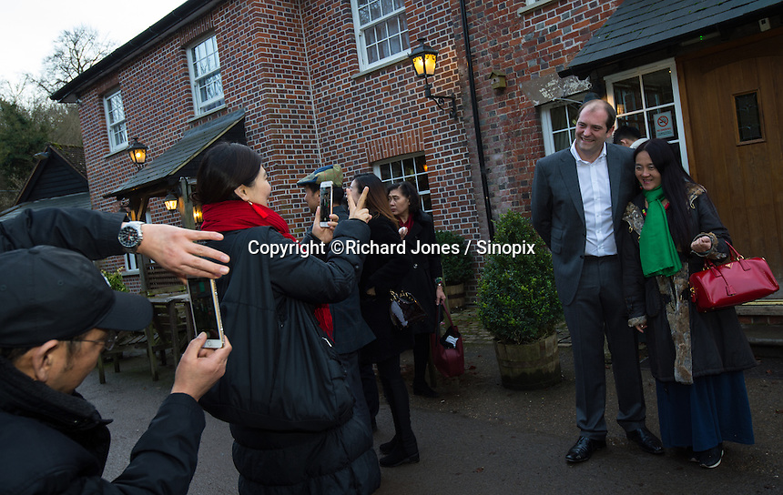 Chinese business people based in the UK pose  with Matthew Walsh, Town Mayor & Chairman, Princes Risborough Town Council, outside The Plough at Cadsden, Buckinghamshire. SinoFortone Group bought the pub after it was visited by Chinese Premiere Ji Jinping last year, and aim to develop  a chain of English-style pubs China.<br /> <br /> Photo by Richard Jones