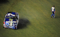 Jul. 4, 2008; Daytona Beach, FL, USA; Nascar Nationwide Series driver Mike Wallace walks away from his car after crashing on the last lap during the Winn-Dixie 250 at Daytona International Speedway. Mandatory Credit: Mark J. Rebilas-