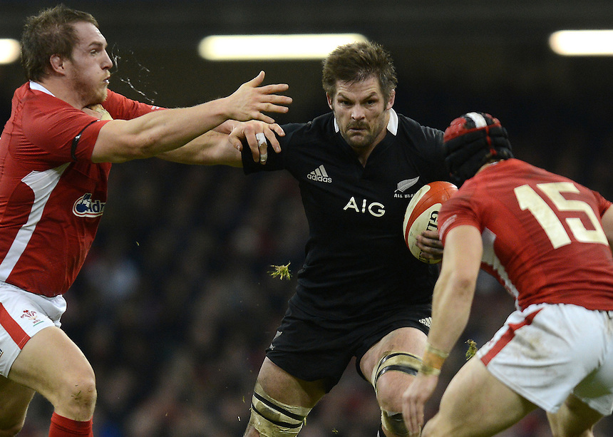 New Zealand's Richie McCaw holds off Wales' Gethin Jenkins ..International Rugby Union - Wales v New Zealand - Saturday 24th November 2012 - Millennium Stadium - Cardiff....