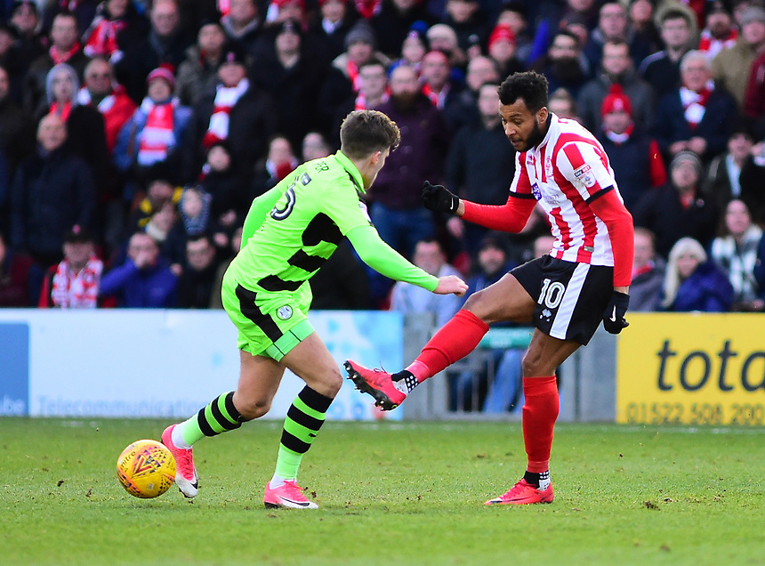 Lincoln City's Matt Green vies for possession with Forest Green Rovers' Charlie Cooper<br /> <br /> Photographer Andrew Vaughan/CameraSport<br /> <br /> The EFL Sky Bet League Two - Lincoln City v Forest Green Rovers - Saturday 30th December 2017 - Sincil Bank - Lincoln<br /> <br /> World Copyright &copy; 2017 CameraSport. All rights reserved. 43 Linden Ave. Countesthorpe. Leicester. England. LE8 5PG - Tel: +44 (0) 116 277 4147 - admin@camerasport.com - www.camerasport.com