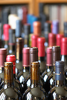 Many bottles and bottle necks in preparation for a large winetasting.