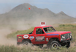 Justin Berg works his way around the course at the beginning of the Buffalo Chip 100 off-road racing event Saturday at the T.O.R.C. track in Sturgis, S.D. Bear Butte served as a backdrop for the event. (Photo by Richard Carlson/Inertia)