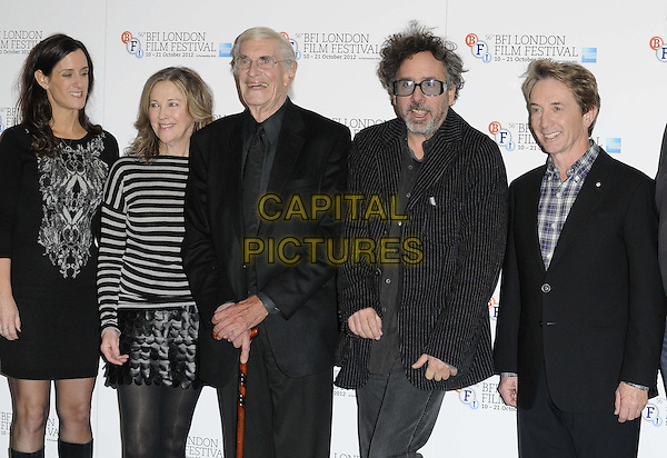 Allison Abbate, Catherine O'Hara, Martin Landau, Tim Burton & Martin Short.'Frankenweenie' photocall ahead of the 56th BFI London Film Festival Opening Gala, Corinthia Hotel, London, England..10th October 2012.half length black white stripe top suit grey gray skirt leather scales profile pinstripe glasses beard facial hair dress.CAP/CAN.©Can Nguyen/Capital Pictures.