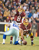 Washington Redskins quarterback Kirk Cousins (8) directs the offense as he prepares to take the snap from center Josh LeRibeus (67)in fourth quarter action against the Dallas Cowboys at FedEx Field in Landover, Maryland on Monday, December 7, 2015.  Dallas Cowboys defensive tackle Nick Hayden (96) prepares to defend.  The Cowboys won the game 19-16.<br /> Credit: Ron Sachs / CNP