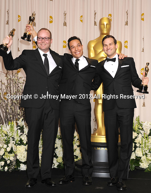 HOLLYWOOD, CA - FEBRUARY 26: Rich Middlemas, T.J. Martin and Dan Lindsay pose in the press room at the 84th Annual Academy Awards held at Hollywood & Highland Center on February 26, 2012 in Hollywood, California.