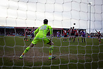 Home keeper Kieran O'Hara prepares to make a save from a free-kick as Morecambe (in red stripes) hosted Plymouth Argyle in a League 2 fixture at the Globe Arena. The stadium was opened in 2010 and replaced Morecambe's traditional home of Christie Park which had been their home since 1921, the year after their foundation. Plymouth won this fixture by 2-0 watched by 2,081 spectators, in a game delayed by 30 minutes due to traffic congestion affecting travelling Argyle fans.