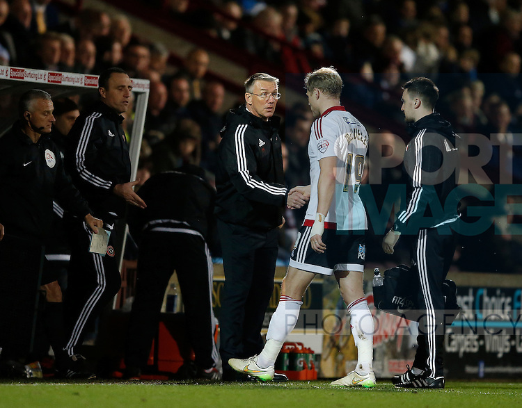 Nigel Adkins manager of Sheffield Utd checks on James McEveley of Sheffield Utd - English League One - Scunthorpe Utd vs Sheffield Utd - Glandford Park Stadium - Scunthorpe - England - 19th December 2015 - Pic Simon Bellis/Sportimage