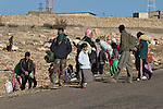 11/12/2014. Sinjar Mountain, Iraq. Yazidi refugees queue on a road on Mount Sinjar where they hope to be evacuated by Iraqi Air Force Helicopters. <br /> <br /> Although a well publicised exodus of Yazidi refugees took place from Mount Sinjar in August 2014 many still remain on top of the 75 km long ridge-line, with estimates varying from 2000-8000 people, after a corridor kept open by Syrian-Kurdish YPG fighters collapsed during an Islamic State offensive. The mountain is now surrounded on all sides with winter closing in, the only chance of escape or supply being by Iraqi Air Force helicopters.