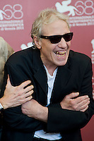 Abel Ferrara poses during the photocall of 'Last day on earth' at the 68th Venice Film Festival