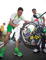 17 SEP 2011 - LA BAULE, FRA - EC Sartrouville team managers Eric Dubois (left) and Denis Véron (right) check their competitors bikes in transition before the start of the final round of the men's French Grand Prix Series at the Triathlon Audencia in La Baule, France .(PHOTO (C) NIGEL FARROW)