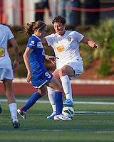 In a National Women's Soccer League Elite (NWSL) match, the Boston Breakers defeated the Western New York Flash  2-1, at Dilboy Stadium on May 5, 2013.  Western New York Flash forward Abby Wambach (20) stops the ball as Boston Breakers midfielder Heather O'Reilly (9) attempts a tackle.