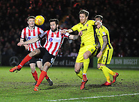 Lincoln City's Ollie Palmer vies for possession with Cheltenham Town's Jamie Grimes<br /> <br /> Photographer Andrew Vaughan/CameraSport<br /> <br /> The EFL Sky Bet League Two - Cambridge United v Lincoln City - Friday 9th February 2018 - Abbey Stadium - Cambridge<br /> <br /> World Copyright &copy; 2018 CameraSport. All rights reserved. 43 Linden Ave. Countesthorpe. Leicester. England. LE8 5PG - Tel: +44 (0) 116 277 4147 - admin@camerasport.com - www.camerasport.com