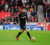 2nd December 2017, bet365 Stadium, Stoke-on-Trent, England; EPL Premier League football, Stoke City versus Swansea City;  Ki Sung-Yueng of Swansea City moves the ball out of midfield