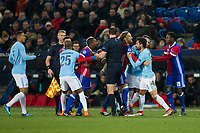 Manchester City's Ilkay Gundogan reacts angrily to a challenge by Basel's Serey Die and has to be restrained by team mates <br /> <br /> Photographer Craig Mercer/CameraSport<br /> <br /> UEFA Champions League Round of 16 First Leg - Basel v Manchester City - Tuesday 13th February 2018 - St Jakob-Park - Basel<br />  <br /> World Copyright &copy; 2018 CameraSport. All rights reserved. 43 Linden Ave. Countesthorpe. Leicester. England. LE8 5PG - Tel: +44 (0) 116 277 4147 - admin@camerasport.com - www.camerasport.com