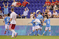 John Morrison (15) of FC New York celebrates scoring with teammates. The New York Red Bulls defeated FC New York 2-1 during a third round match of the 2011 Lamar Hunt US Open Cup at Red Bull Arena in Harrison, NJ, on June 28, 2011.