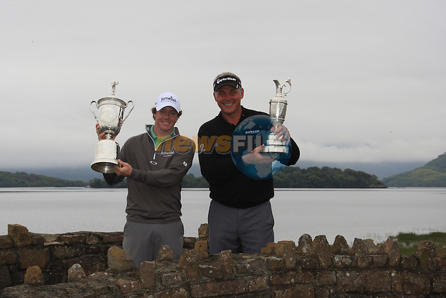 Rory McIlroy (NIR) 2011 U.S. Open Champion and Darren Clarke (NIR) 2011 Open Champion hold their respective trophies aloft on the bridge near the 1st tee during the Pro-Am of The Irish Open presented by Discover Ireland at Killarney Golf & Fishing Club on Wednesday 27th July 2011 (Photo Fran Caffrey/www.golffile.ie)