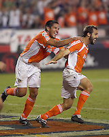 Houston Dynamo forward Brian Ching (l) and Dynamo midfielder Brian Mullan (r) celebrate Mullan's goal. Houston Dynamo beat the  Colorado Rapids 3-1 to clinch the Western Conference Championship at Robertson Stadium in Houston, TX on November 5, 2006.