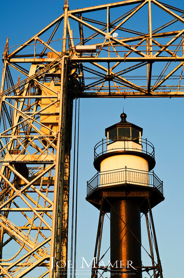 South breakwater inner lighthouse and aerial lift bridge in Duluth, Minnesota.