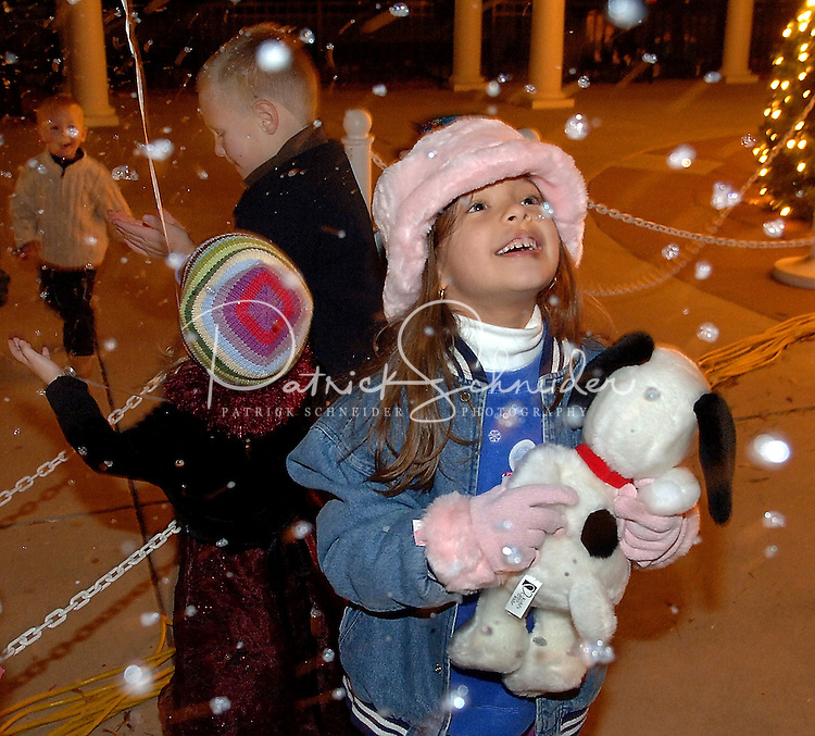 Children dance in a fake-snowfall during the annual Christmas tree lighting event at Birkdale Village in Huntersville, NC. Birkdale Village combines the best of shopping, dining, apartments and entertainment venues within a 52-acre mixed-use development.