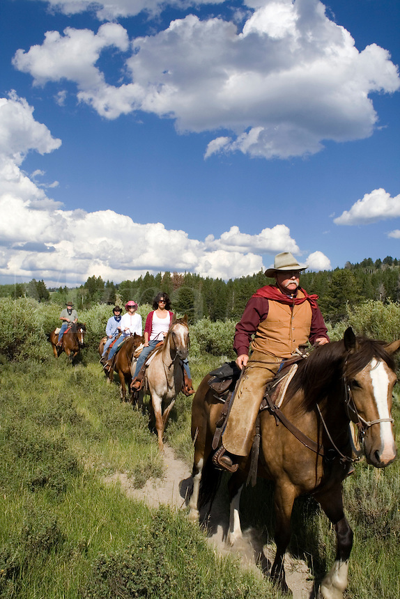 Wrangler leading a trail ride at Triangle X Dude Ranch in Grand Teton National Park