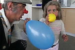 "Cris L'ariste an Israeli  medical clown who works in Hadassah and he is a member of a group call ""Dream Doctor"", plays with a Maria (no second name given), a Palestinian girl, at the Oncology Day Care unit at Hadassah Ein Karem hospital. Photo by Quique Kierszenbaum."