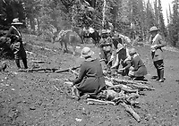 Six women and one man in riding attire tend to a campfire in western United States, horses in background, circa 1930's.   (photo: www.bcpix.com)