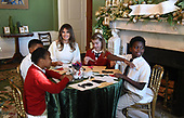 First Lady Melania Trump participates in arts and crafts projects with children and students from Joint Base Andrews in the Green Room of the White House in Washington, DC, November 27, 2017.<br /> Credit: Olivier Douliery / Pool via CNP