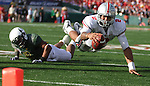 Ohio State quarterback Terrelle Pryor is upended by Oregon's Spencer Paysinger in the 96th Rose Bowl in Pasadena, Ca January 1, 2010.