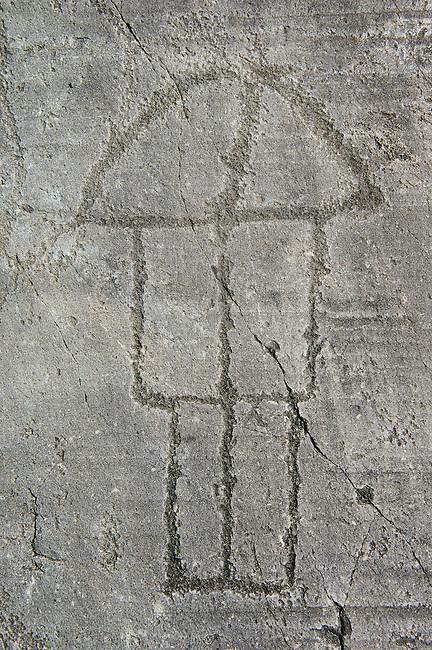 Petroglyph, rock carving, of a house on stilts. Carved by the ancient Camunni people in the iron age between 1000-1200 BC. Rock no 6, Foppi di Nadro, Riserva Naturale Incisioni Rupestri di Ceto, Cimbergo e Paspardo, Capo di Ponti, Valcamonica (Val Camonica), Lombardy plain, Italy