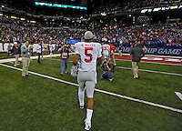 Ohio State Buckeyes quarterback Braxton Miller (5) walks off the field after losing to Michigan State Spartans in the Big 10 Championship game at Lucas Oil Stadium in Indianapolis, Ind on December 7, 2013.  (Dispatch photo by Kyle Robertson)