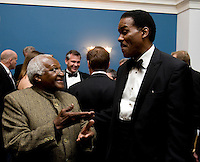 Archbishop Desmond Tutu speaks with US Soccer Foundation President and CEO Ed Foster-Simeon at a reception hosted by Representative James Clyburn at the US Capitol prior to the US Soccer Foundation Gala held at City Center in Washington, DC.