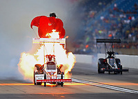 Jul 11, 2015; Joliet, IL, USA; NHRA top fuel driver T.J. Zizzo explodes an engine on fire during qualifying for the Route 66 Nationals at Route 66 Raceway. Mandatory Credit: Mark J. Rebilas-USA TODAY Sports